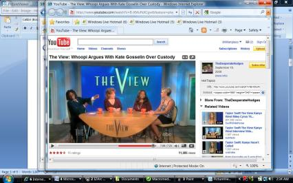Whoopi distances herslef from the group. Her adrenalin is pumping as her arm is stretched out.